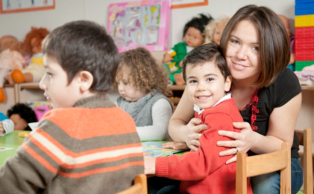Woman with young boy in classroom